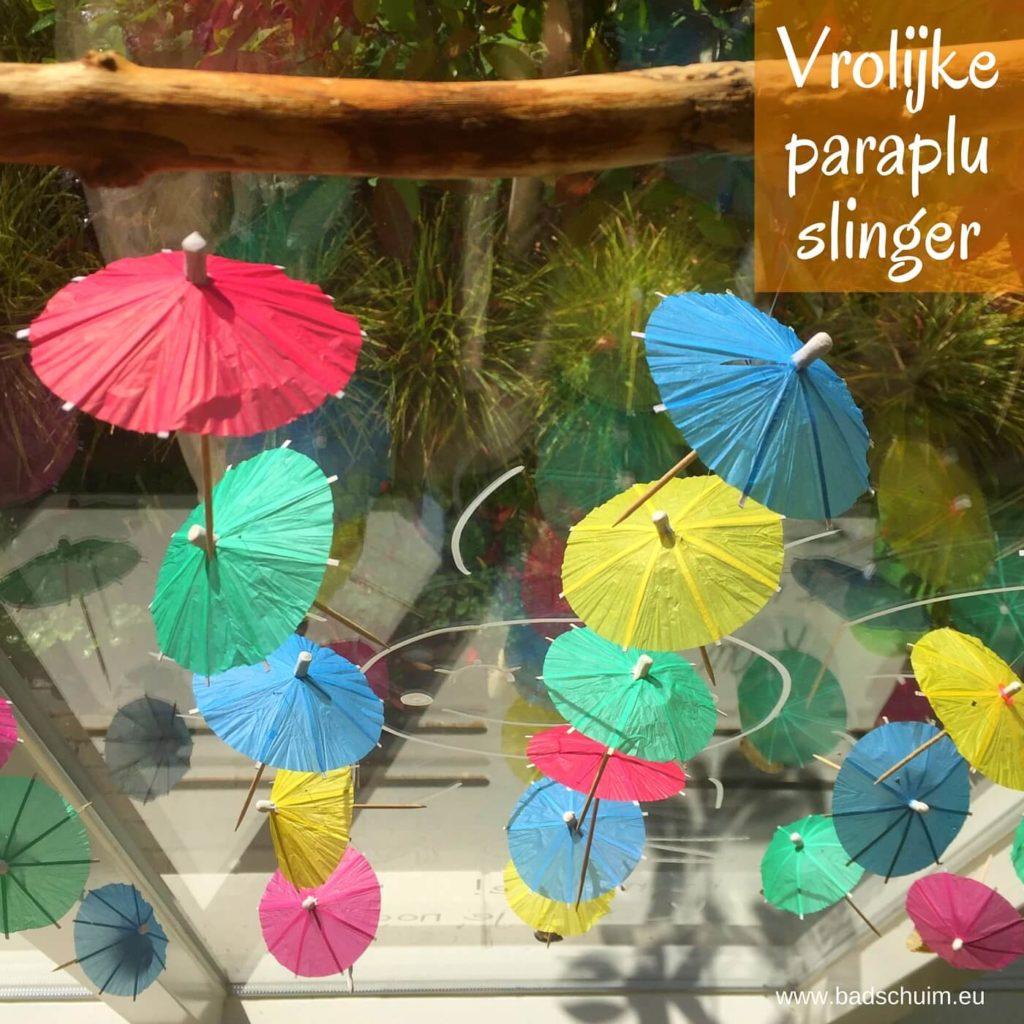 Zomerse DIY met vrolijk, gekleurde paraplu's: de paraplu slinger! Ze bungelen gezellig voor mijn raam en zorgen elke keer weer voor een lach op mijn gezicht. Maak hem ook zelf met dit DIY stappenplan!